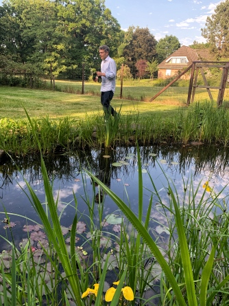 The master gardener inspecting the water lilies